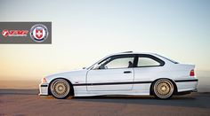 White BMW e36 coupe on HRE wheels
