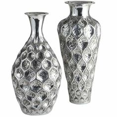 "Embossed Vases -- short, 10.25"" diameter x 20.25"" high, reg 99.95, clearance $69.98 / tall, 9"" diameter x 22"" high, reg 119.95, clearance $79.98."