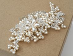 Luxurious vintage inspired floral hair comb with gleaming pearls and twinkling crystals, the perfect hair accessory for nestling in bridal