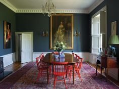 TABLE TALK | In the dining room, red spindle-back chairs from Ikea liven up an...
