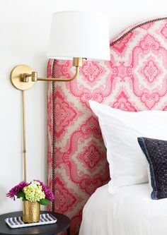 While Lonergan kept the bedrooms simple and mostly undecorated, she credits the upholstered headboards and matching bed skirts as each room's finishing touch. This one is in a rich pink fabric by Manuel Canovas.