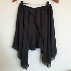 Isabel Marant Black Silk Skirt Layered black silk skirt with raw edge hem and elastic waist band. Short and straight back hem, longer asymmetric front. Size 1. Will fit XS-S. Isabel Marant Skirts Mini