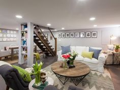 The unfinished basement of a classic Atlanta bungalow gets a major overhaul with a mix of rough, reclaimed elements and stylish, soft furnishings.