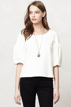 I would pair this top with some cute denim overalls dress