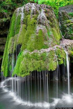 The water on this waterfall in Romania rolls off of a green carpet of moss that covers the rock formation — which results in a magically soft display, much unlike a roaring waterfalls. Who knew Mother Nature had so many tricks up her sleeve? Beautiful Waterfalls, Beautiful Landscapes, Beautiful Scenery Pictures, Natural Waterfalls, Beautiful Images, Cascade Falls, Nature Landscape, Nature Nature, Landscape Photos