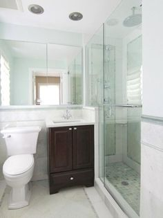 Marble and mirrors are a great way to make a smaller #bathroom #design appear larger and more #beatufiul