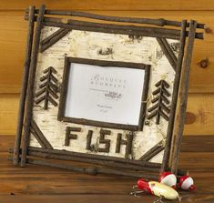 """Frame your favorite fishing picture in this Birch Bark and twig picture frame.14""""L x 12""""H. Holds one 4"""" x 6"""" photo"""