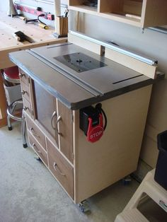 Router table cabinet - As great as this concept is, it is not advisable to completely enclose the router as shown. The motor could burn up if it does not have adequately air circulation. Subtract the door in front of the router mounting area and this is a great way to keep router bits and accessories organized.