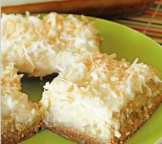 1 - Combine flour, 1 cup sugar and 1 cup butter. Pat mixture into ungreased 9 X 13 pan. Bake at 350 oven for 14-19 minutes. Cool slightly. 2 - Mix together cream cheese, 4 TBS sugar, milk and eggs. Fold in vanilla, and drained pineapple. Spread over baked crust. 3 - Combine coconut and 2 TBS melted butter. Sprinkle over pineapple layer filling. Bake 350 for 15-20 minutes.