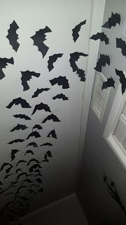 Paper bats on the ceiling. Great way to give your house something extra this Halloween.  Kelsey's Craft Corner