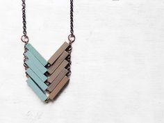 Hey, I found this really awesome Etsy listing at https://www.etsy.com/listing/180396674/wood-geometric-necklace-pistachio