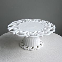 "I have the shallow fruit bowl or ""banana bowl"" I need this: Milk Glass Cake Stand by Fostoria in the Monroe Pattern."