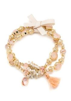 A pretty bracelet for day into evening, this stretch style features a set of two slip-on bracelets crafted in gold-tone with cubic zirconia and pink faceted stones.