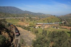 The Tehachapi Loop, California. Built in 1874 and still going. That's one long train...