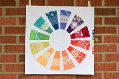Color Wheel mini quilt, has link to pattern with 16 instead of 12 wedges. From In Color Order