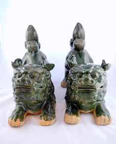 A pair of large Fo dog figurines, temple guardians, green glazed terracotta, China 19, Jh, L x W x H 57 x 23 x 48 cm    Dealer  Art & Auction Walter Ginhart    Auction  Minimum Bid:  800.00 EUR      Dealer  Kunst- & Auktionshaus Walter Ginhart    Auction  Minimum Bid:  800.00 EUR
