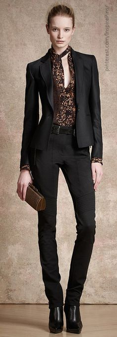 SUIT: Wear a lacy camisole or plain T-shirt under the jacket then play up make-up, jewellery and hair.