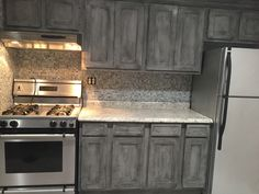 Annie Sloan Paris Grey with black wax on kitchen cabinets