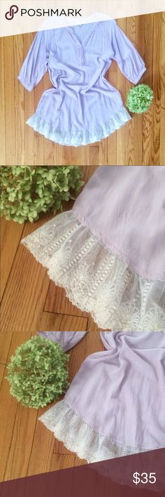 Beautiful Umgee Tunic! This Pale Lilac tunic dress is so pretty and perfect for spring.  Feminine Lace hem and elbow length sleeves.  Very tiny discoloration- Absolutely unnoticeable.  Noticed a loose thread on back.  Not sheer, but may want to wear a slip.  Simple & Beautiful! Sz S. Umgee Tops Tunics