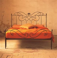 Love this wrought iron bed