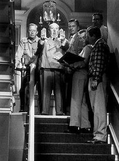 Alfred Hitchcock on the set of Dial M for Murder, 1954. Nothing quite like a Hitchcock film.