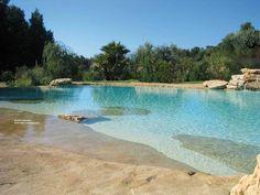 area relax: piscina naturale in sabbia e roccia ricostruita - waterworld