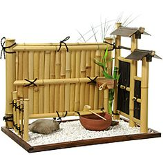 @Overstock - Indoor personal rock garden, crafted using genuine bleached and dark stained bamboo rods. Walnut stained, mitered wood frame holds light pebbles and larger stone. Bamboo and wood faux-fountain and clay bowl.http://www.overstock.com/Worldstock-Fair-Trade/Zen-Bamboo-Mini-Rock-Garden-China/6668882/product.html?CID=214117 $131.99