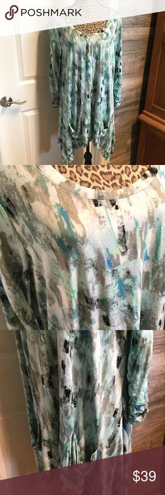 Paintbrush Print Tunic An awesome shark bite hem Tunic with ruched sleeves and 2 patch pockets. Sides are longer. Scoop neckline. Soft stretch knit. Great Spring Print...aqua, turquoise, blue....gray and black accents. Long length...covers everything! Premise Studio Tops Tunics