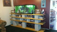 Cinder blocks wood stained and 75 gal fish tank love this and it was easy diy