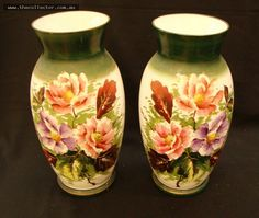 Lot 365 - Pair of Victorian  glass mantle vases with hand painted floral still life and gilt highlight - H 35 cm - ( 1 af)