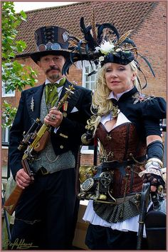 Classy Coordinated Steampunk Couple - For costume tutorials, clothing guide, fashion inspiration photo gallery, calendar of Steampunk events, & more, visit SteampunkFashionGuide.com