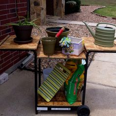 Repurposing an old grill base for a gardening cart... Helps to have a handy husband to make this idea happen.