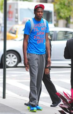 Kevin Durant wearing Nike Air Trainer 1.3 Max Breathe Blue Glow & a shoot til my arm falls off shirt