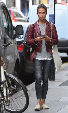 (August 27) in London, England. Wearing Acne Mock red wine leather jacket