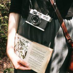 botanical book and film camera