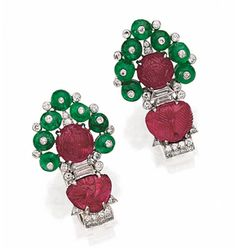 "PAIR OF CARVED RUBY, EMERALD BEAD AND DIAMOND ""TUTTI FRUTTI"" CLIPS, CARTIER, CIRCA 1925.  Of modified arrow shape, decorated with 4 carved rubies and 14 emerald beads, further set with 66 old European-cut and single-cut diamonds and 4 baguette and fancy-shaped diamonds, mounted in platinum, signed Cartier, one numbered 54-46615, the other with worn serial number. With red leather box stamped Cartier."