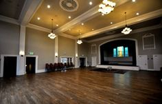great hall at greenlake- 12 hr rental is $2400, $2040 for greenlake residents. Includes chairs and tables- max occupancy is 100-160 depending on seating arrangement
