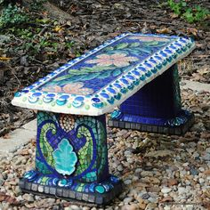 Mosaic Garden Bench = I can do that with my plain grey concrete bench! I got my order of indoor/outdoor ceramic tiles in a rainbow of colors, so I'm ready to go any time!