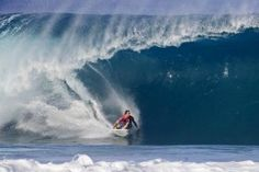 Surfer catching the Banzai Pipeline along North Shore