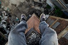 Daredevil Dennis Maitland, 24, climbs into lift shafts, up former office blocks and over the edge of balconies to snap his incredible photos, looking directly down.