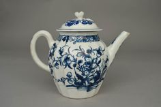 1981,0101.285 DescriptionTeapot and lid(not matching); ribbed, oviform body with faceted spout and ribbed handle; decorated in underglaze blue with oriental flowers and rocks; border of scrolls and diaper panels round rim; spout and handle decorated with blue scrolls and flowers; floral knop on lid with flower spray and two lines round rim; pot marked. More  Producer nameFactory of: Worcester Porcelain Factory biography Date1751-1783 Height: 12.5 centimetres
