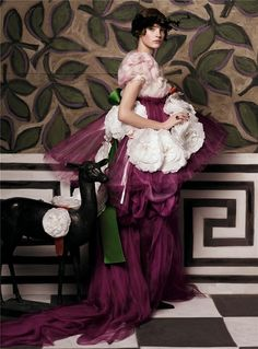 """Editorial: """"Fashioning The Century""""  Magazine: Vogue US  Issue: May 2007  Photographer: Steven Meisel  Model: Natalia Vodianova  Wardrobe: Christian Lacroix hand-painted crepeline-and-organza cyclamen peplum dress and organdy flower ribbon belt"""
