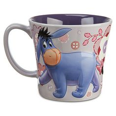"New.  Disney Eeyore Spring Floral Mug / Cup.  Holds approx. 12 oz.  3 1/2"" H x 4 1/4 D  Dishwasher and microwave safe.  Disney cups also make great plant containers.  Just add some pebbles for drainage, then some potting soil and last, your plant."