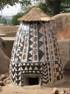 Not a home, but a Grainery, with ground entrance for the chicken that helps remove bug pests. The royal court Tiébélé, Burkina Faso