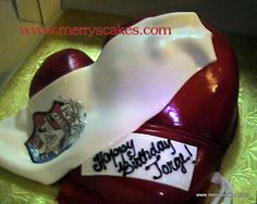 This Boxing glove cake was created by us at Merry's Custom Cakes.