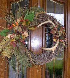 my deer antler wreath smaller slightly different than the crafts, seasonal holiday decor, wreaths Deer Antler Crafts, Antler Wreath, Hunting Wreath, Feather Wreath, Antler Art, Feather Crafts, Wreath Crafts, Diy Wreath, Wreath Ideas
