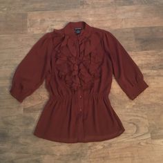 Brown sheer blouse Button up with Ruffles and elastic around waist. Mid-length sleeves. Perfect with flare jeans and boots. Tops Button Down Shirts