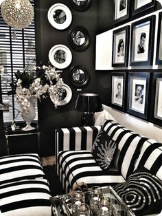 I love this black and white room.  It's so easy to mimic with cabana ebony slipcovers. You can buy black frames at ikea or a dollar store and accessories with silver or gold candle holders, trays and other great home decor trinkets you have a home.