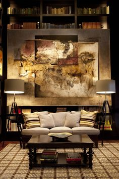 I love the drama of this interior. The dark wall mixed with the softer earthy tones. It's absolutely gorgeous.