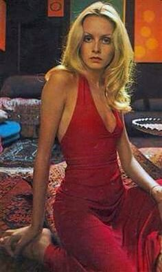 The effervescent Twiggy in a red halter maxi dress circa 1970s.